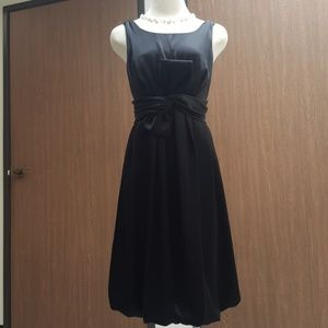 Beautiful black dress with a front bow